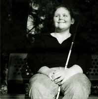 Adolescent on park bench with white cane