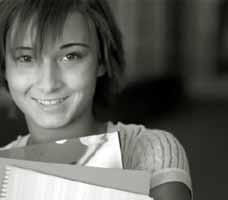 Smiling adolescent holding books
